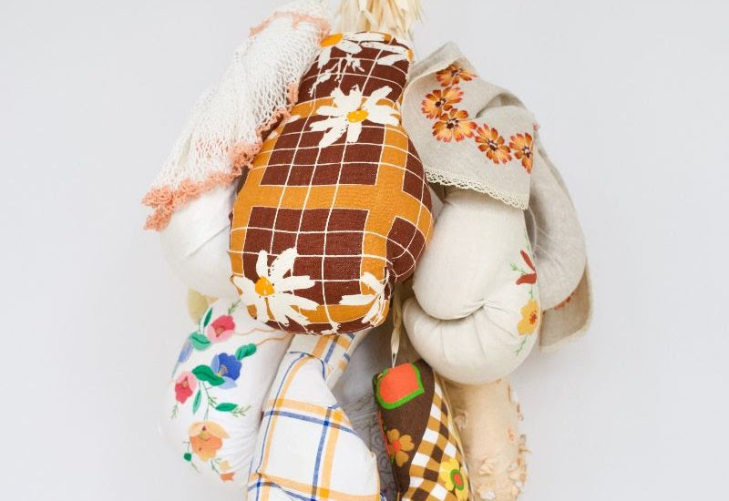 Zoë Buckman, According To Grandma, 2019, 12 boxing gloves, vintage linen, chain, 29 x 19 x 15 1/2 inches.